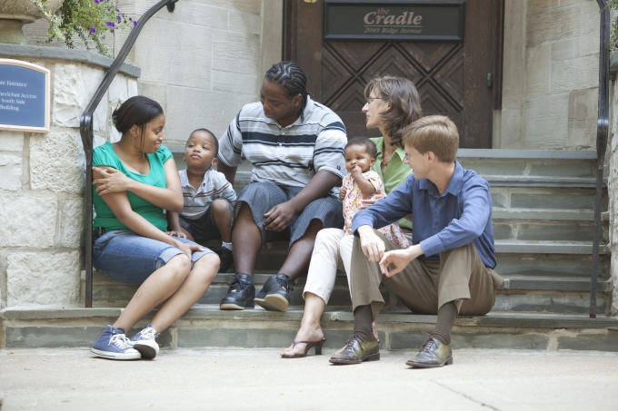 A birth and adoptive family in an open adoption. Pictured here at the steps of The Cradle